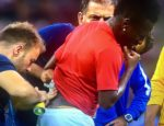 Asamoah Gyan in pain as he was treated on the pitch