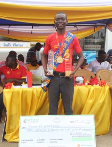 Famous Boateng, 2016 Shell Regional and Global Service Champion Displaying his Awards