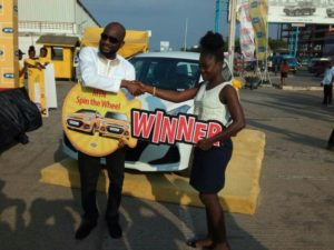 From (l-r) Noel Kojo-Ganson, GM Consumer Marketing, MTN Ghana presenting the keys of the car to Ms Linda Aryee