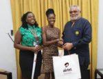 Dinah Coleman (L), Dzifa Amoa ( M) from Airtel Premier Team presenting Airtel souvenirs to Former president Jerry John Rawlings