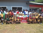 Staff from Airtel Ghana, with staff and pupils from La wireless Cluster of Schools in a pose after the donations