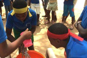 School children washing their hands